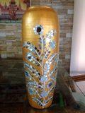 Golden pot with mirror work