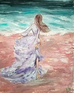Lady walking  to sea beach