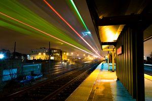 Train passing its station at night