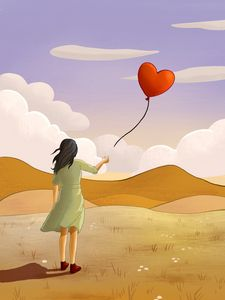 Young girl and heart shaped balloon