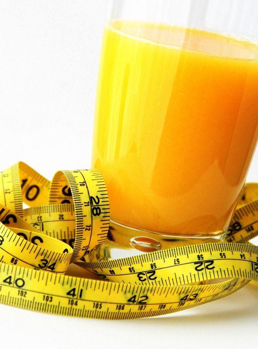 Glass of orange juice and measuring - Valentina Averina
