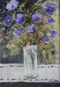 Petunias in a glass vase