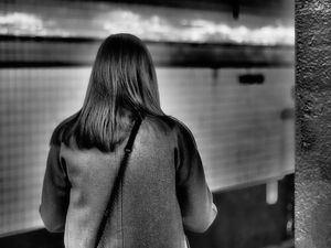 woman waits for train
