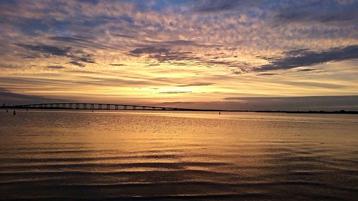 sun setting over a bridge - pace photography