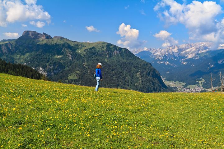 Dolomites - hiker on flowered meadow - Antonio-S