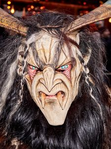 Head shot of a krampus mask