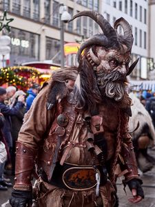 Krampus with load of leather wearing