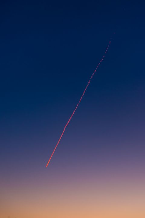 Airplane contrail at sunset. - Natuz