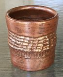 Copper colored pot with texture
