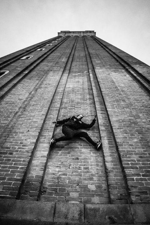 Parkour Athlete climb the wall - Dalibor Balic