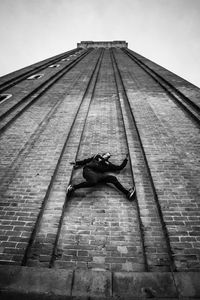 Parkour Athlete climb the wall