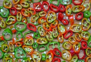 Sliced red and green hot peppers