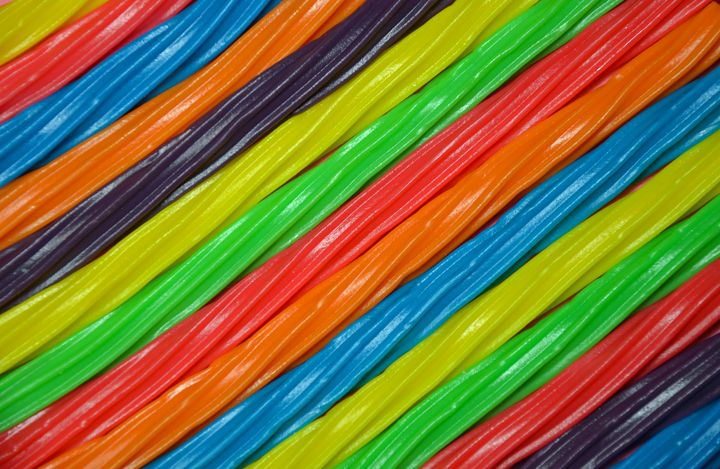 Rainbow colored licorice background - Perl Photography