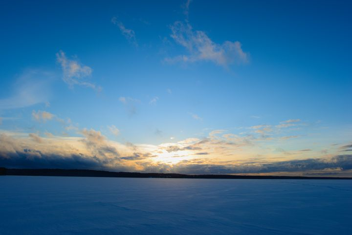 Sunset on the sky over a snowy lake - yarvin13