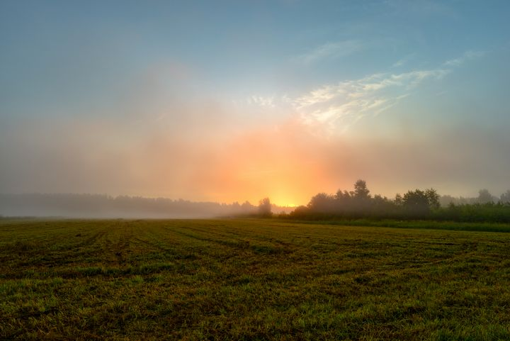 Blue sky at sunrise in a foggy haze - yarvin13
