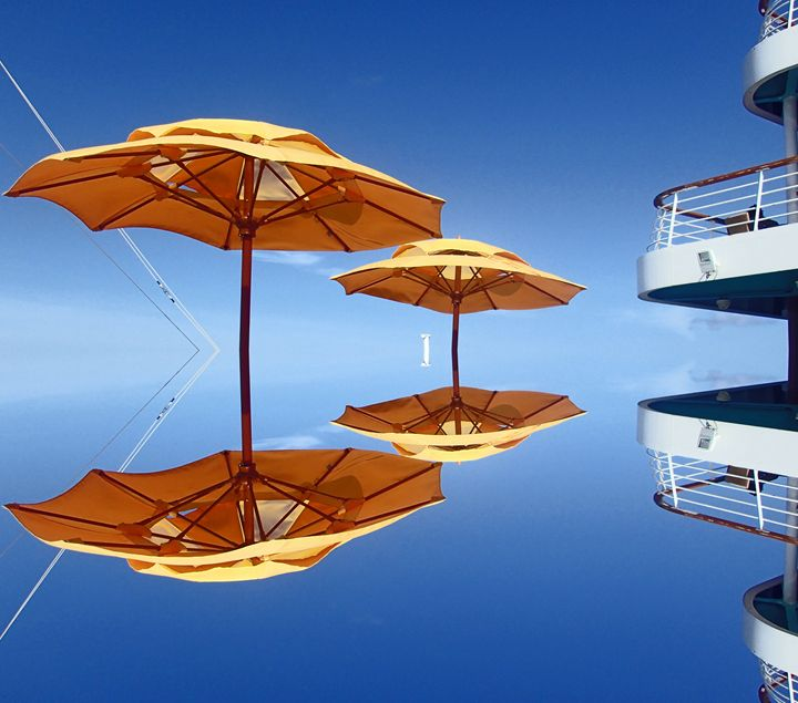 Yellow Umbrellas on Balcony - francine mabie