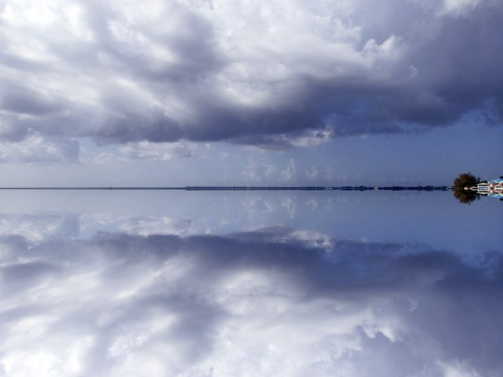 Reflection of Clouds on 7 Mile Beach - francine mabie