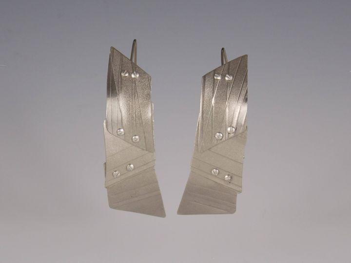 titanium earrings one - Sandra VanderMey