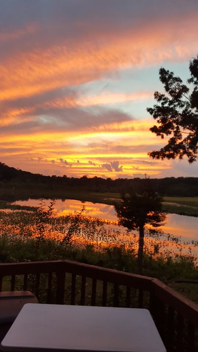 Sunset over water - Spiritual Art by Laurie