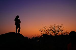 A Girl silhouette at sunrise
