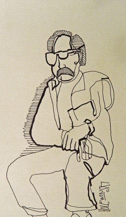 Man Sitting At Book Fair - Holewinski
