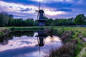 Dutch windmill at sunset