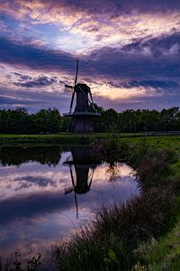 Dutch windmill with water reflection