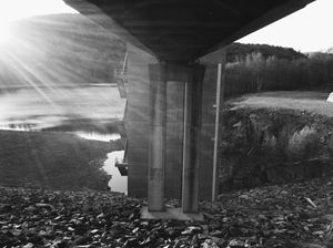 Black and White Sun on Bridge