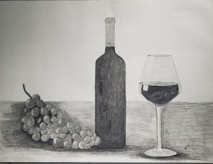 Wine with grapes and glass