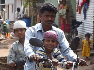 Dad and kids, slum, Hyderabad