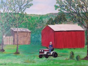 Barn with farmer on tractor.
