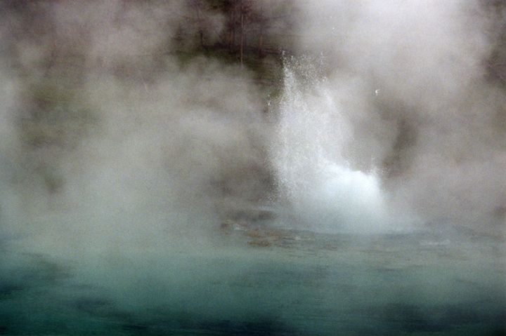Geyser in a Blue Thermal Pool - Wend Images Gallery