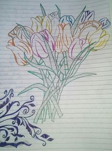 Flower on notebook with pen