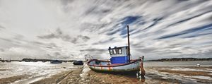 Fishing Boat at low tide - Gem Photography
