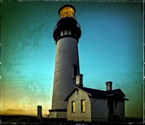Yaquina Head Lighthouse At Sunset