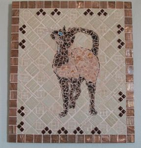 Mosaic painting representing a cat - Chez Palenque