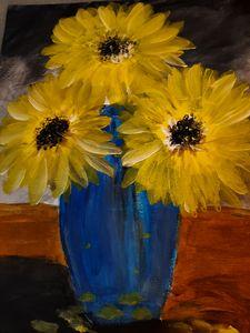Sun-flowers in a blue vase
