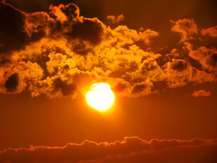 Sun through the clouds - SLM Designs