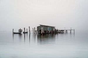 Fishing Hut on Foggy Venetian Lagoon
