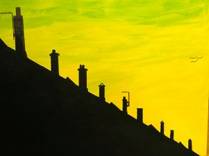 Sunset over chimneys and roofs