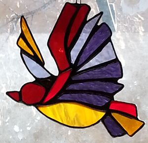 Stained glass flying bird suncatcher