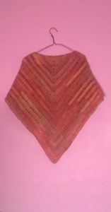 Hand crocheted triangluar shawl
