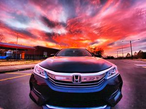 Photo of my car with the sunset
