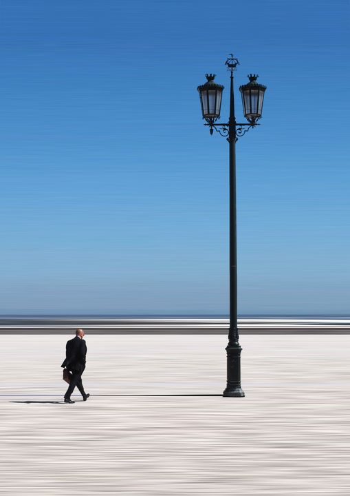 Man walking next to a lamp post - art by vasco