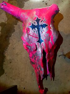 One horn hot pink hydro-dippe steer