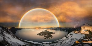 Crater lake with double rainbow