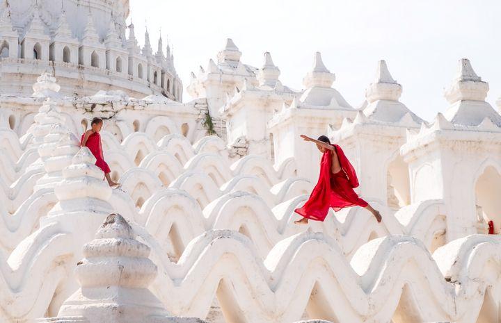 Young monks playing on a pagoda - Nathan Jones