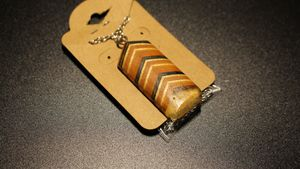 Skateboard and resin amulet