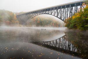 Boat ride with fog under the bridge