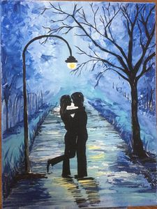 Couple in street light